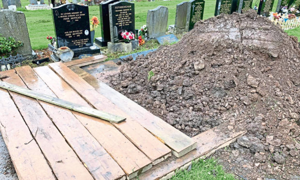 Row after gravediggers get covid