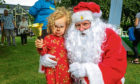 Nula Beattie, 3, from Stobswell ringing Santa's Bell.