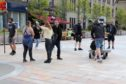 Martin was spotted filming in Dundee City Square.