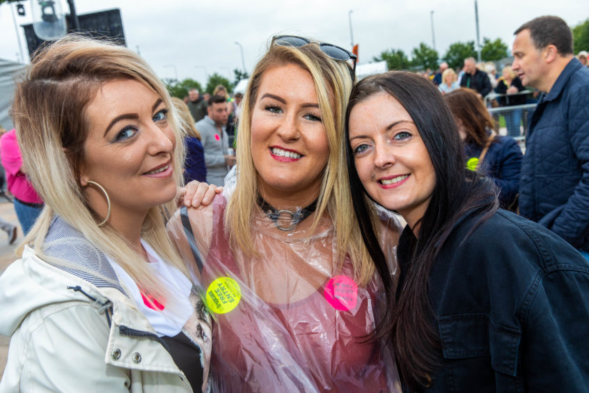 Danielle McGinnes, Kayleigh Patterson and Nicola McGinnes enjoying the concert ,