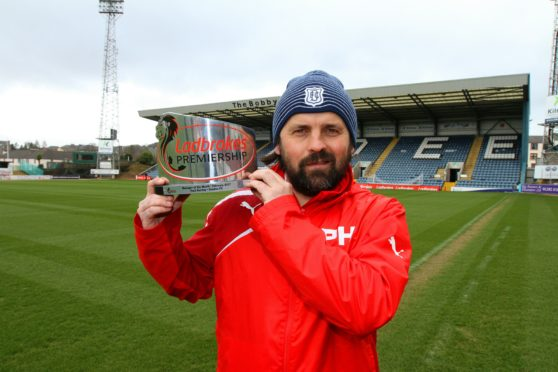 Paul Hartley during his time at Dundee FC, with his manager of the month award.