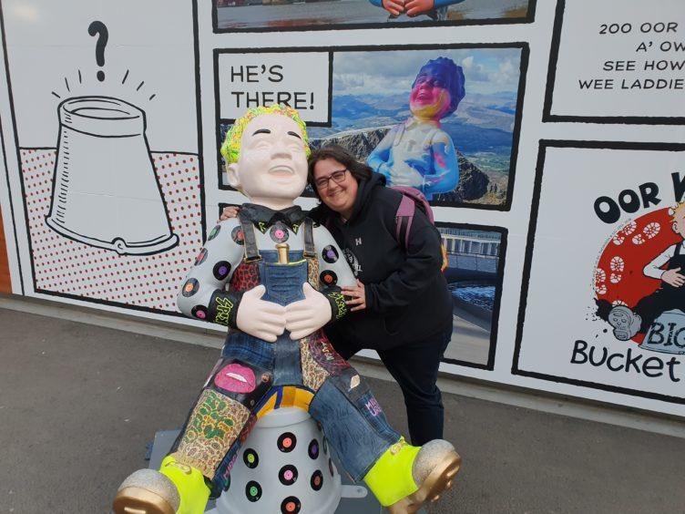 Heather McKenzie, 44, with Aff Yer Rocker Wullie at Edinburgh Railway Station.