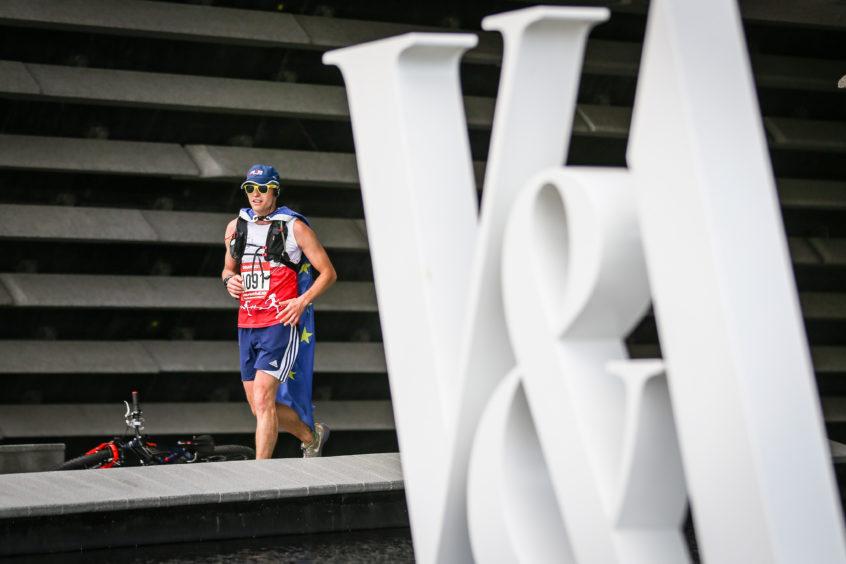 A Dundee Marathon Runner passes the museum.