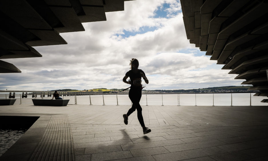 Runners taking part in the DRAM passing V&A Dundee.