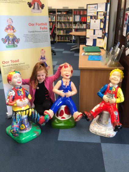 Megan Thornburn with three of the mini Wullies.