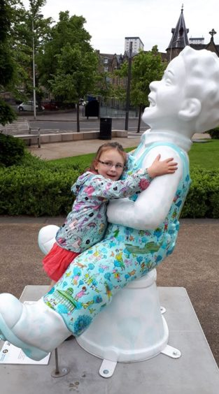 Sophie, 4, loves to give Wullie a cuddle.