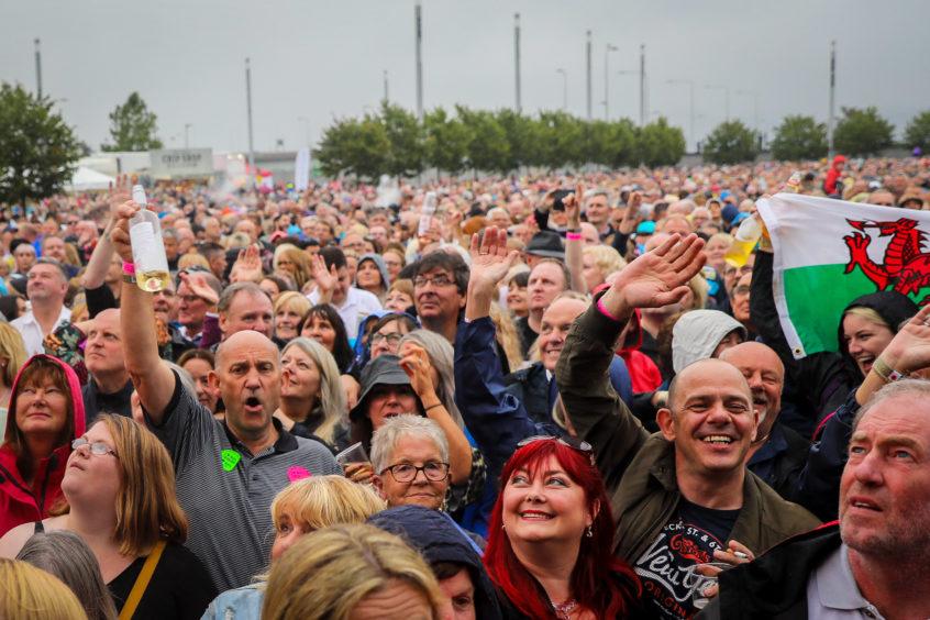 The crowd were in high spirits despite the rain
