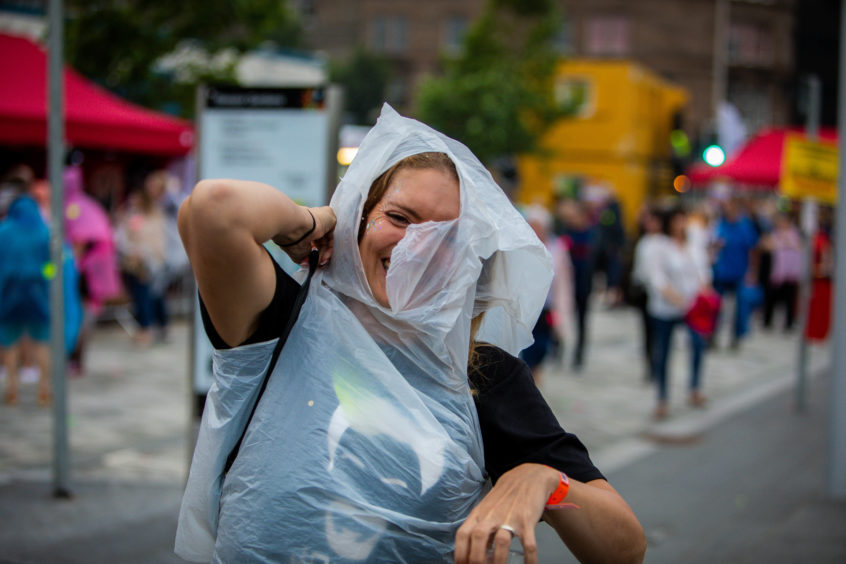 This poncho-wearing reveller enjoyed the experience