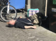 The image of the semi conscious drug user lying in a busy Dundee street caused a huge reaction among locals.