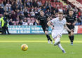 Danny Johnson kept his nerve to convert two spot kicks in Dundee's league opener.
