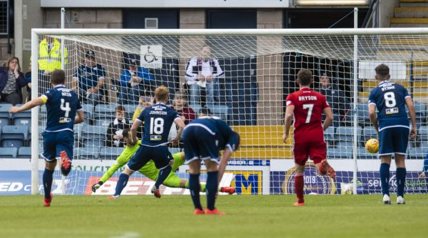 Dundee's Danny Johnson scores the opening goal.