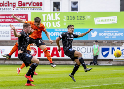 Lawrence Shankland heads home to make it 2-0 to Dundee United.