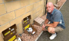 James Kelly, of Broomhill Wynd, has been having a war of words with Hillcrest Housing Association after he was erroneously paying the wrong bill because the meters at his block were mislabelled.