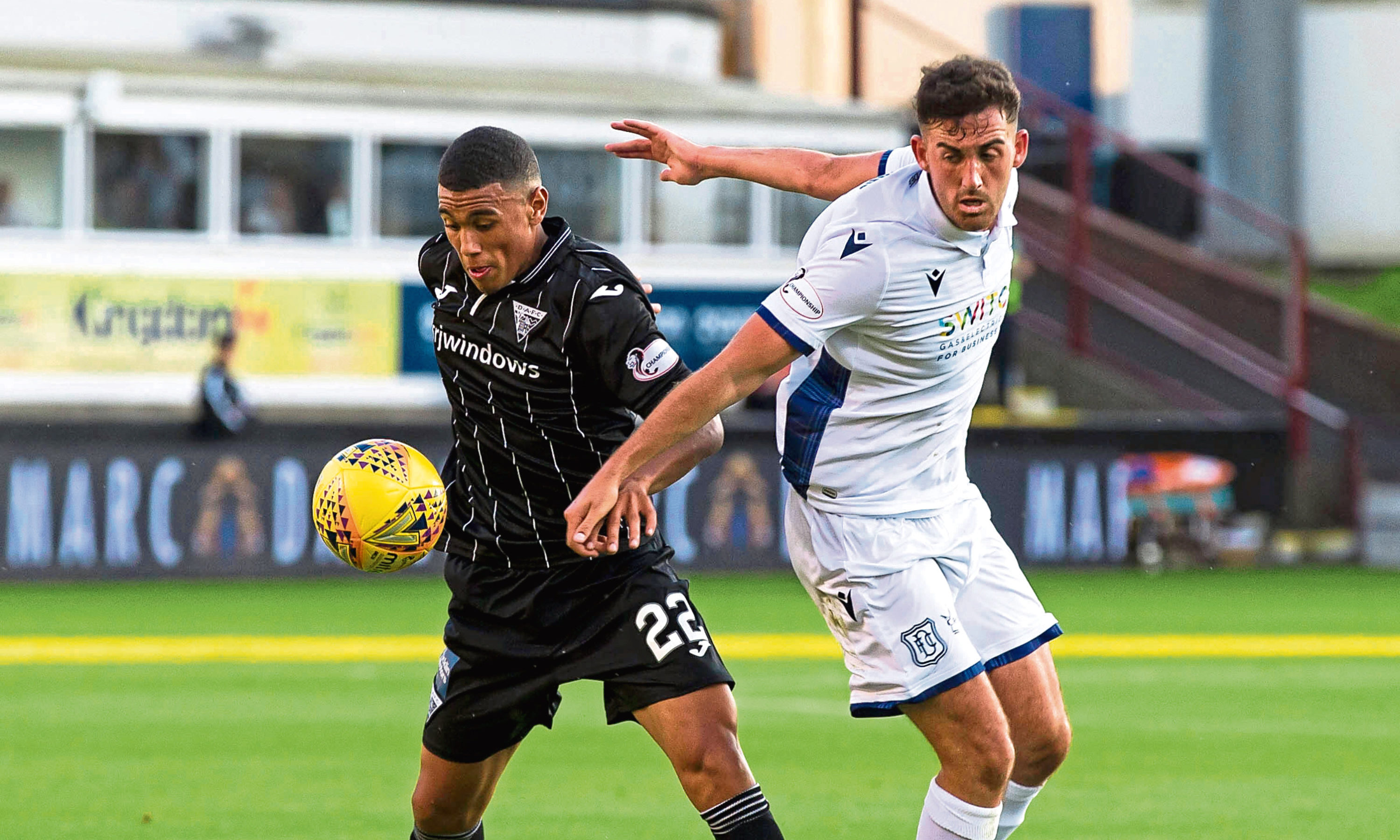 Shaun Byrne battles with Dunfermline's Josh Coley, left.