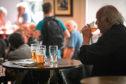 Pub-goers enjoying a pint before lockdown.