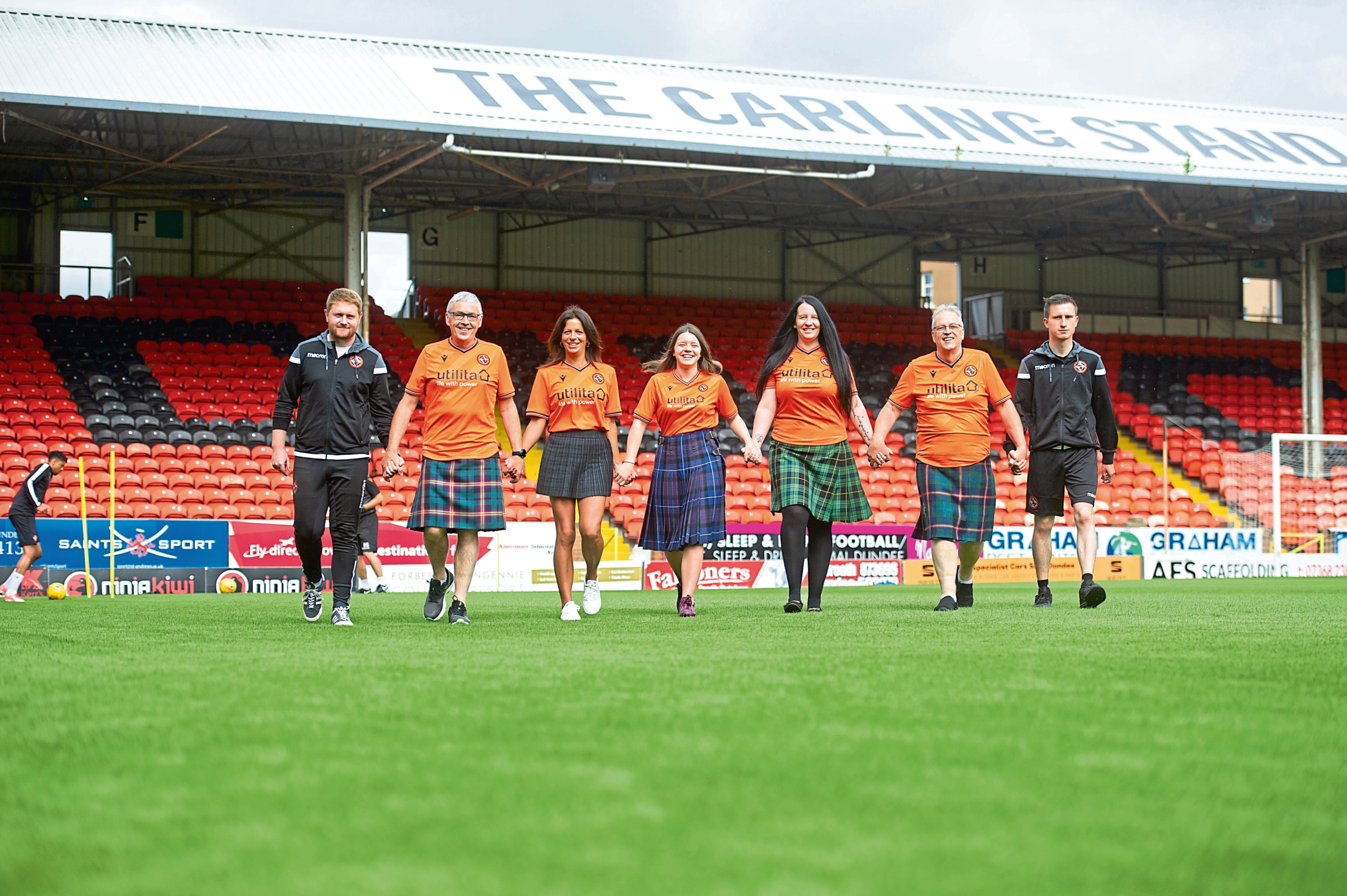 Michael Malone, Charlie Young, Beci Macaskill, Kennedy low, Amanda Low, Robert Young and Michael Anderson at Tannadice. They will all be taking part in the event.