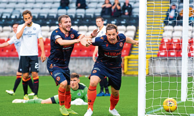 Peter Pawlett, right, wheels away in delight after making it 2-1 to Dundee United.