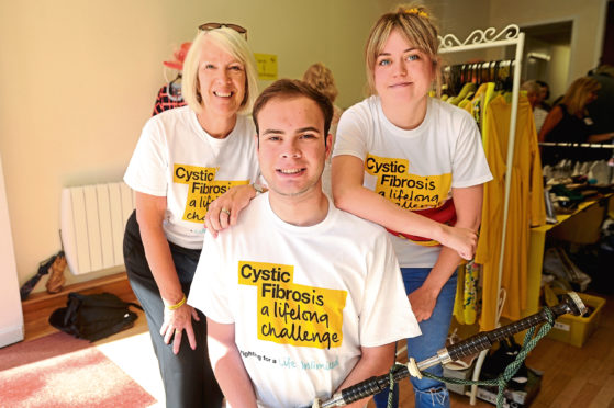 Morag Beckett with son Greg Beckett and Laura Ross, who has helped fundraise for Cystic Fibrosis charities.