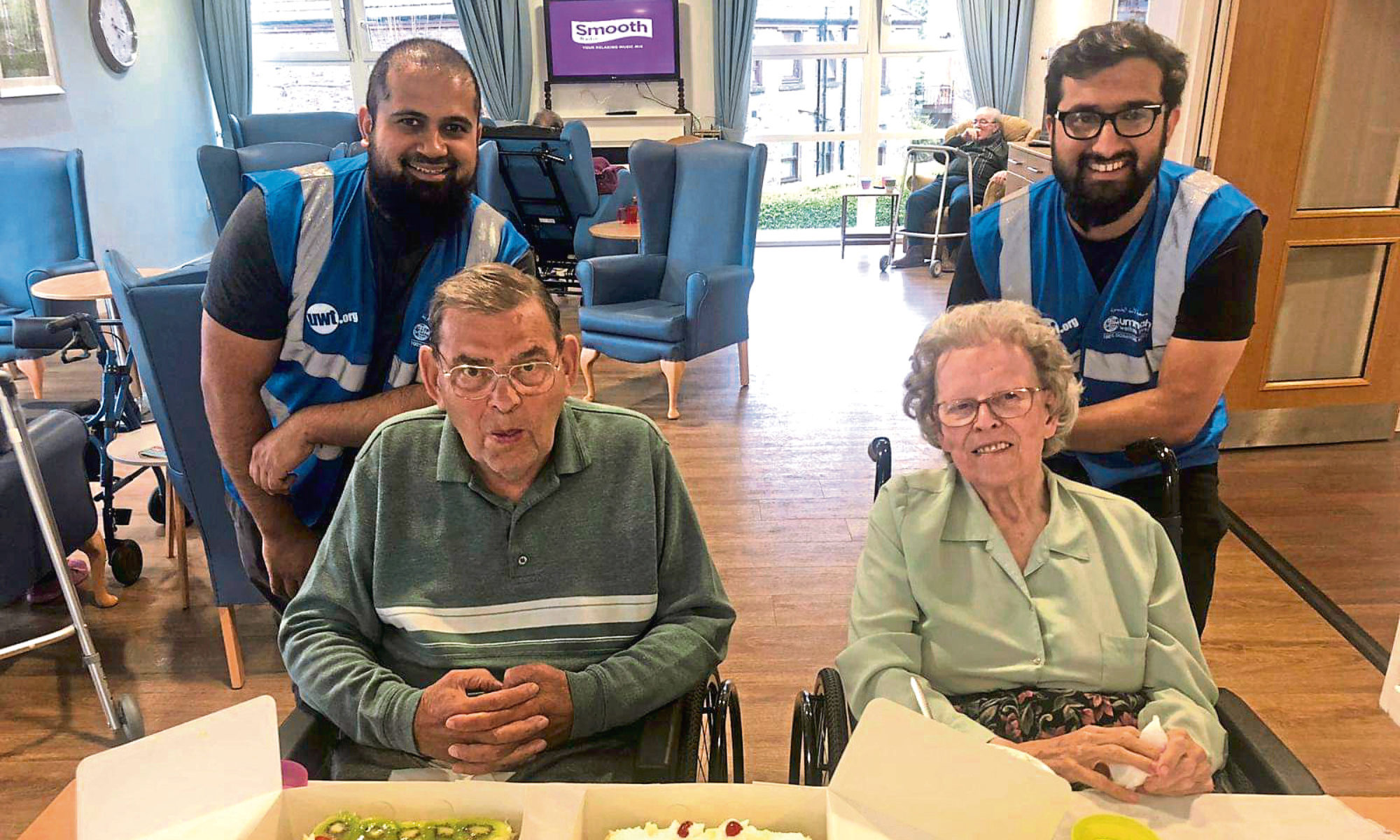 Iftekhar Yaqub and Anees Yaqub with some of the Balhousie Care residents.