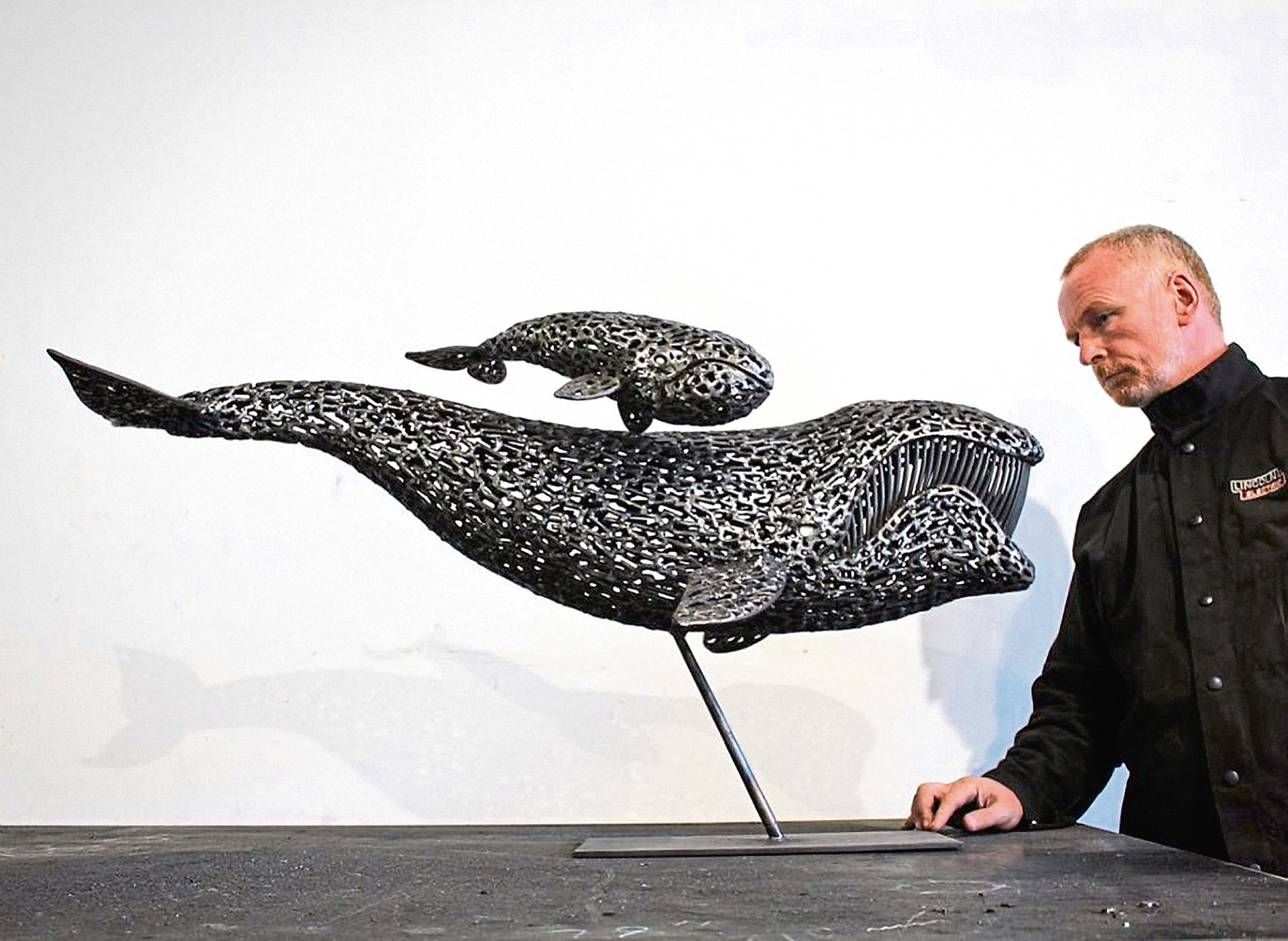 Sculptor Andy Scott with a model of his proposed creation.