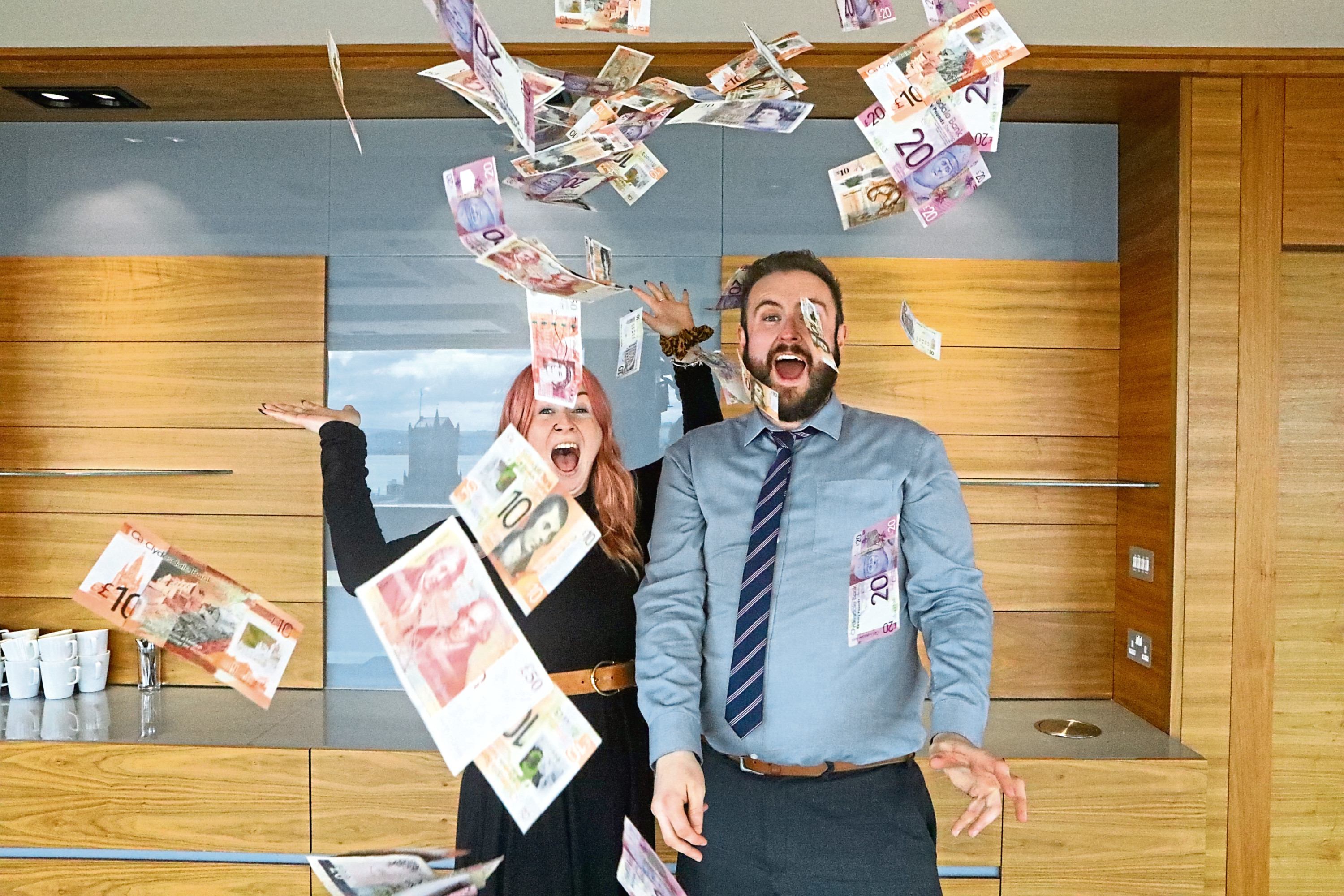 Reporters Amy and Greg today with the £1,000 winning prize money.
