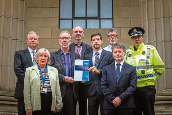 From left: David Martin, Trudy McLeay, David Lynch, Dr Robert Peat, Chairman of the Dundee Drugs Commission, John Alexander, Simon Little, Grant Archibald and Chief Superintendent Andrew Todd.