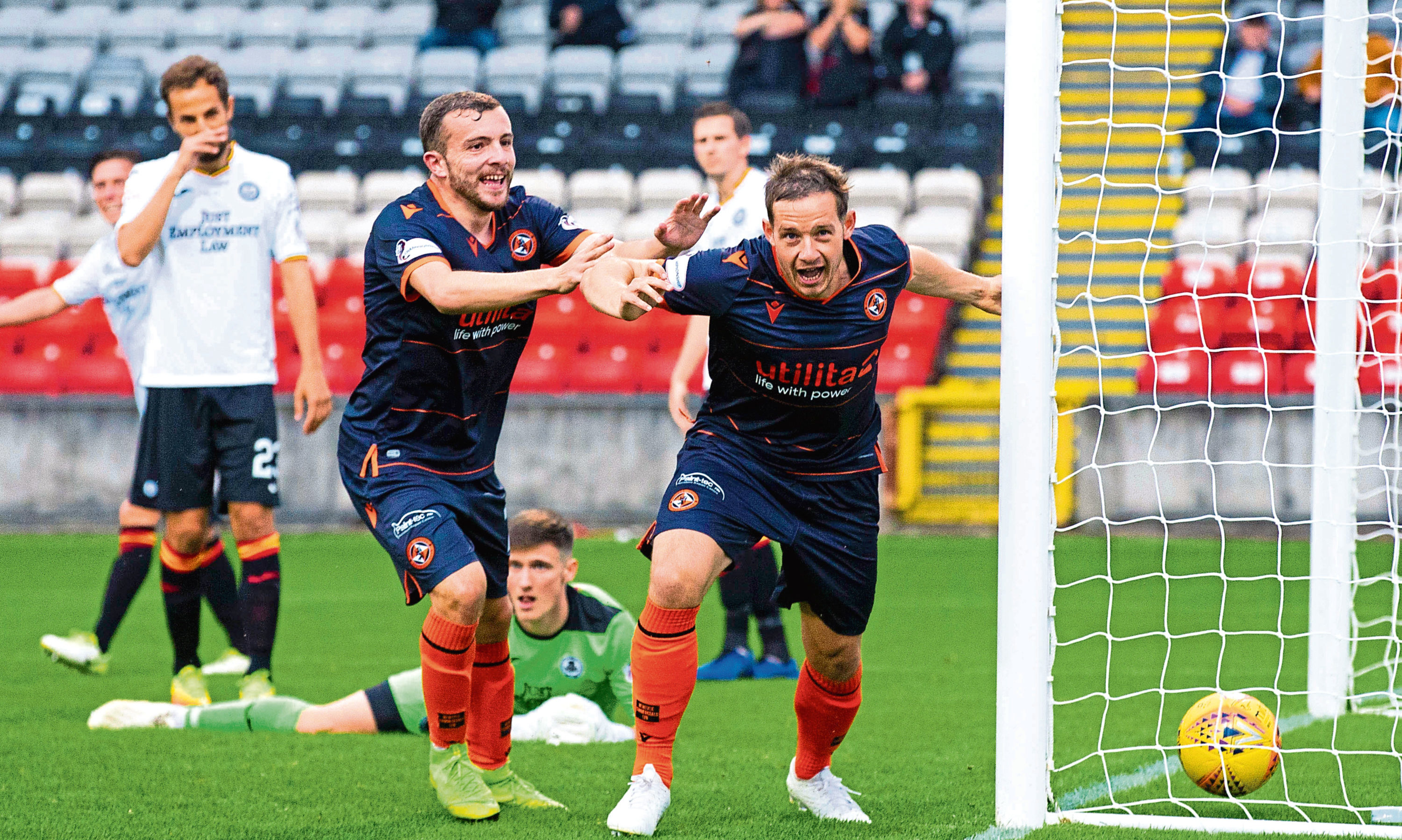 Peter Pawlett, right, runs away in delight after netting for United.