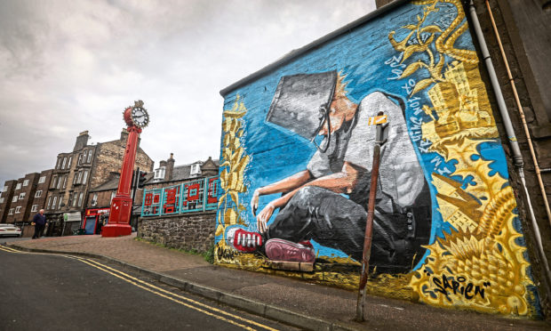 The mural, with the Hilltown Clock visible in the background.