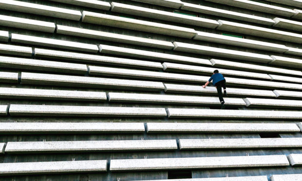 A youngster was captured on camera scaling the V&A Dundee.