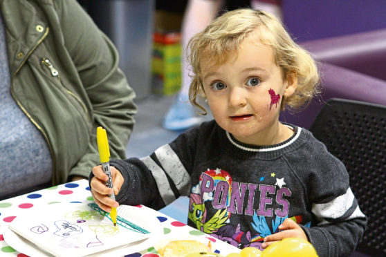 Lilly Menzies, age 2, at the Arts & Crafts table in the Lochee Community Hub.