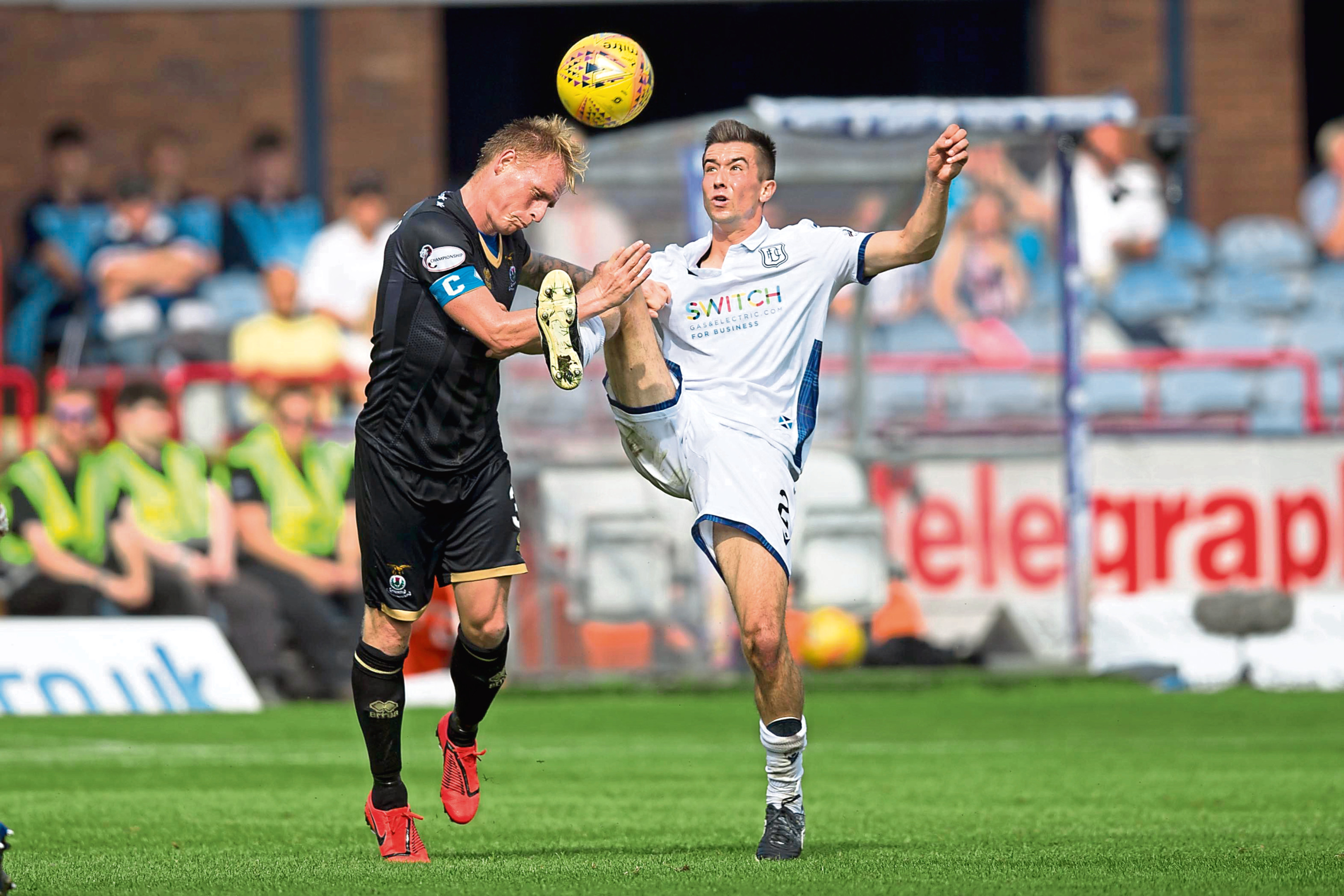 Carl Tremarco of Inverness Caledonian Thistle competes in the air with Cammy Kerr of Dundee.