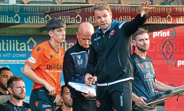 Dundee United's Chris Mochrie with manager Robbie Neilson