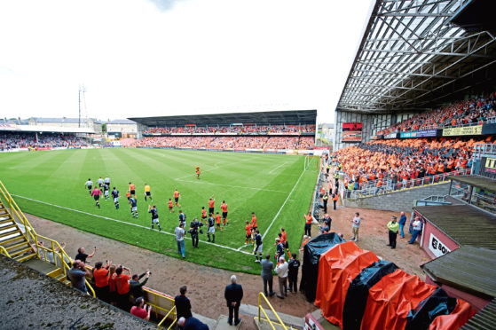The Dundee derby is a sell-out at Tannadice as the teams emerge.
