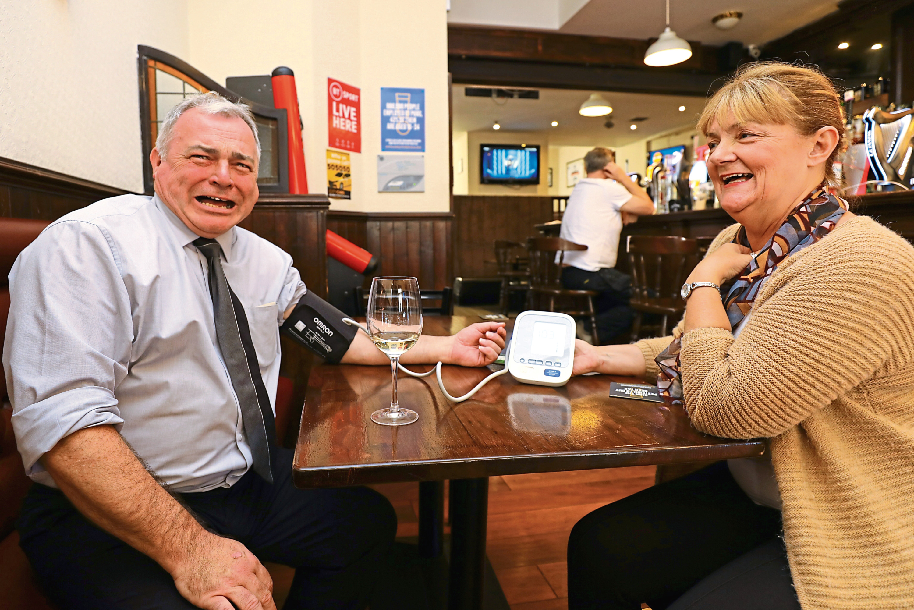 Tele reporter Kenny MacDonald, 'taking one for the team' as he gets his blood pressure checked by Karen Angus.