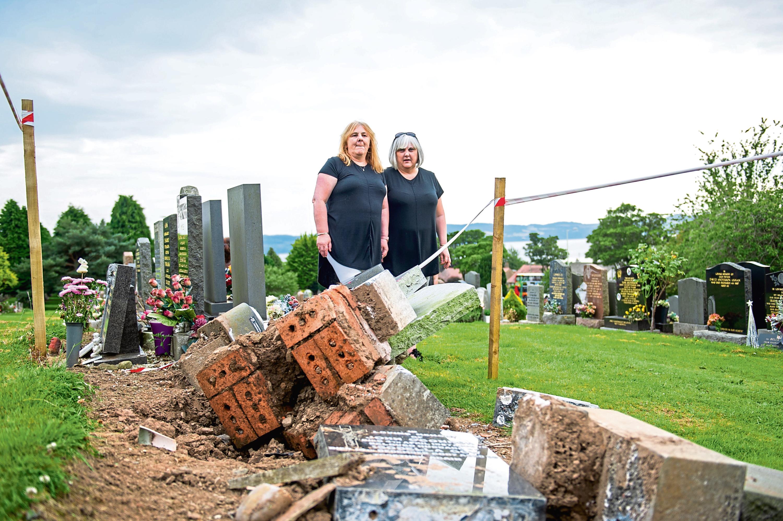Sisters Sandra MacColl and  Lynn Balmer and the damaged headstones.
