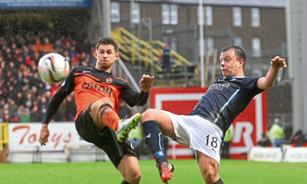 Paul McGowan in action for Dundee.