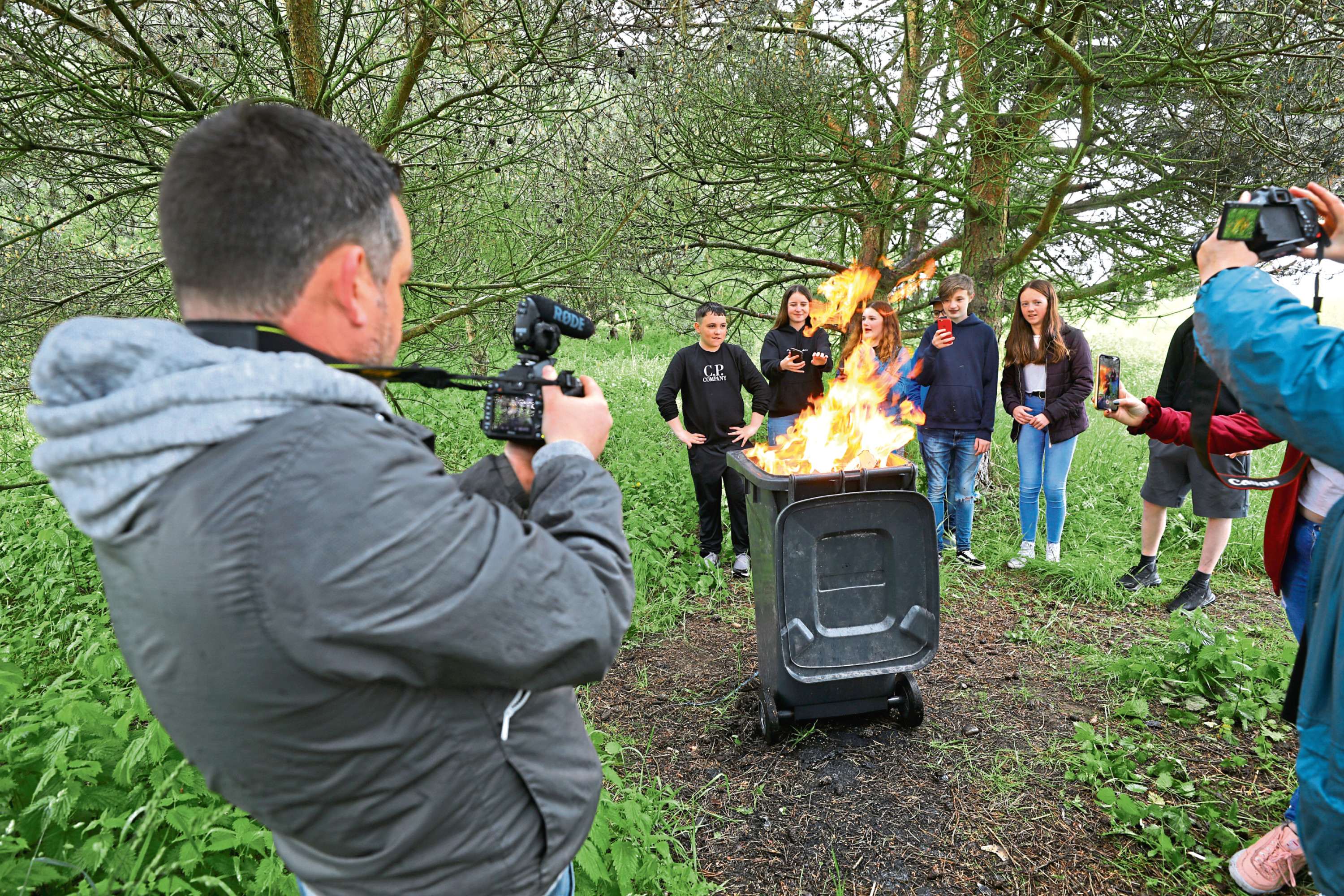 Constable Andy Hutton filming pupils from Braeview Academy drama department for the fire safety film.