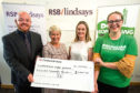 Chris Todd, Virginia Lawson and Kerri Dearsley from RSB Lindsays presenting their cheque to Madeleine Gillan from Macmillan Cancer Support.