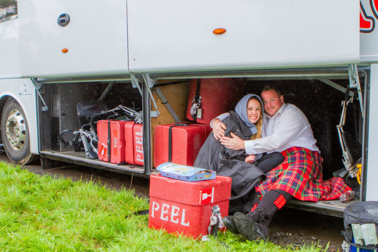 Craig McLean and Meg Sparks from The Peel Regional Police Pipe Band, based in Mississauga, Ontario, sheltering from the rain last year at the games.