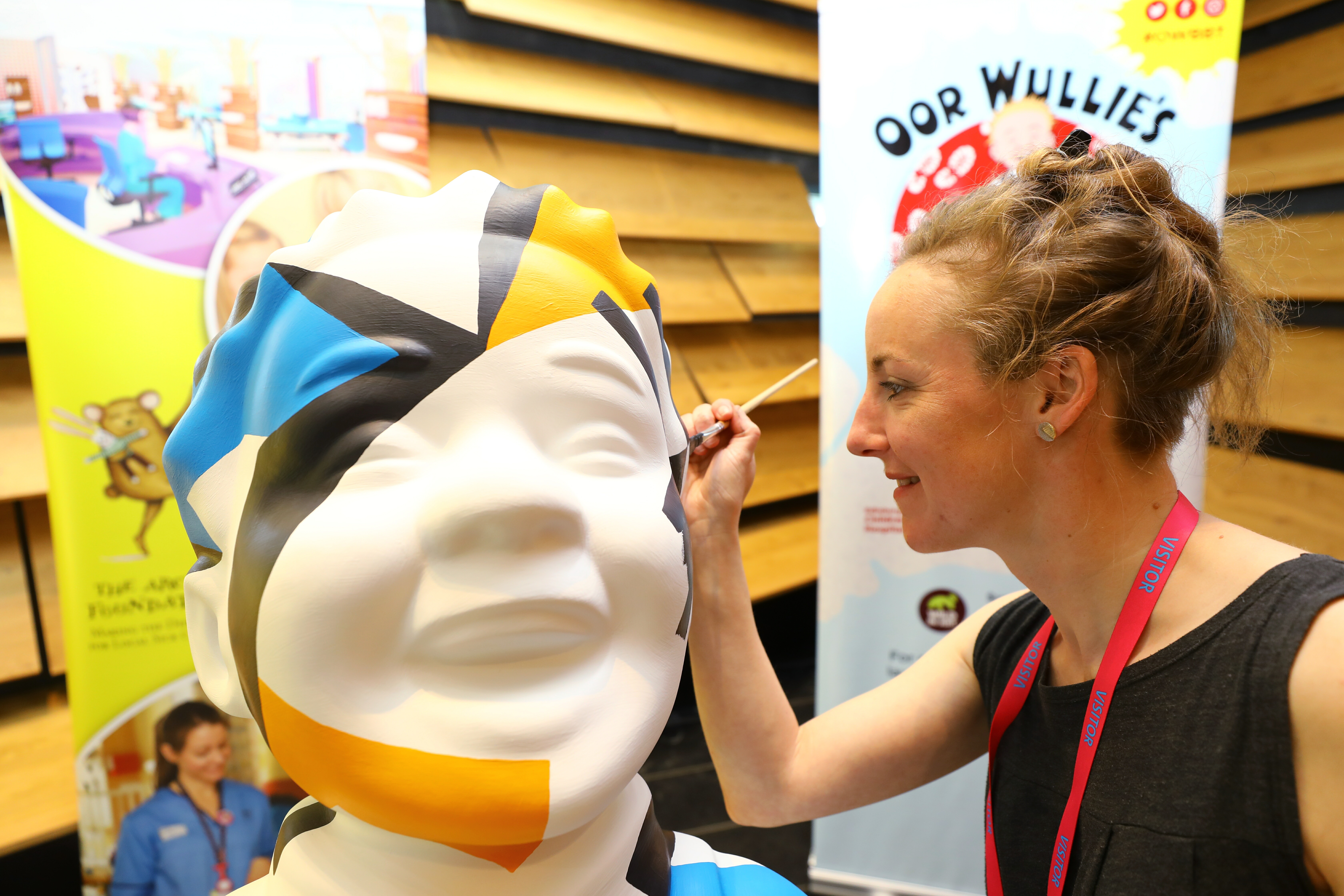Dundee artist Islay Spalding painting her Oor Wullie, 'Dazzle Wullie' at the V&A.