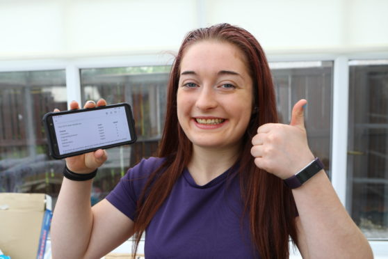 Thumbs up from Lucy Phillips after getting the A grades she was hoping for.