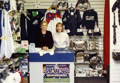 Frances McFadyen and Christine Cross help Dundee FC fans choose their sports gear.