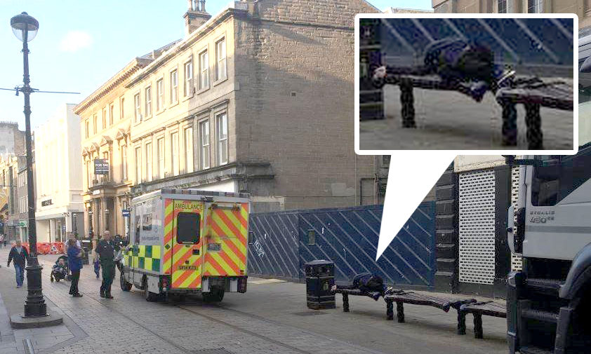 The man was seen lying on a bench on Murraygate.