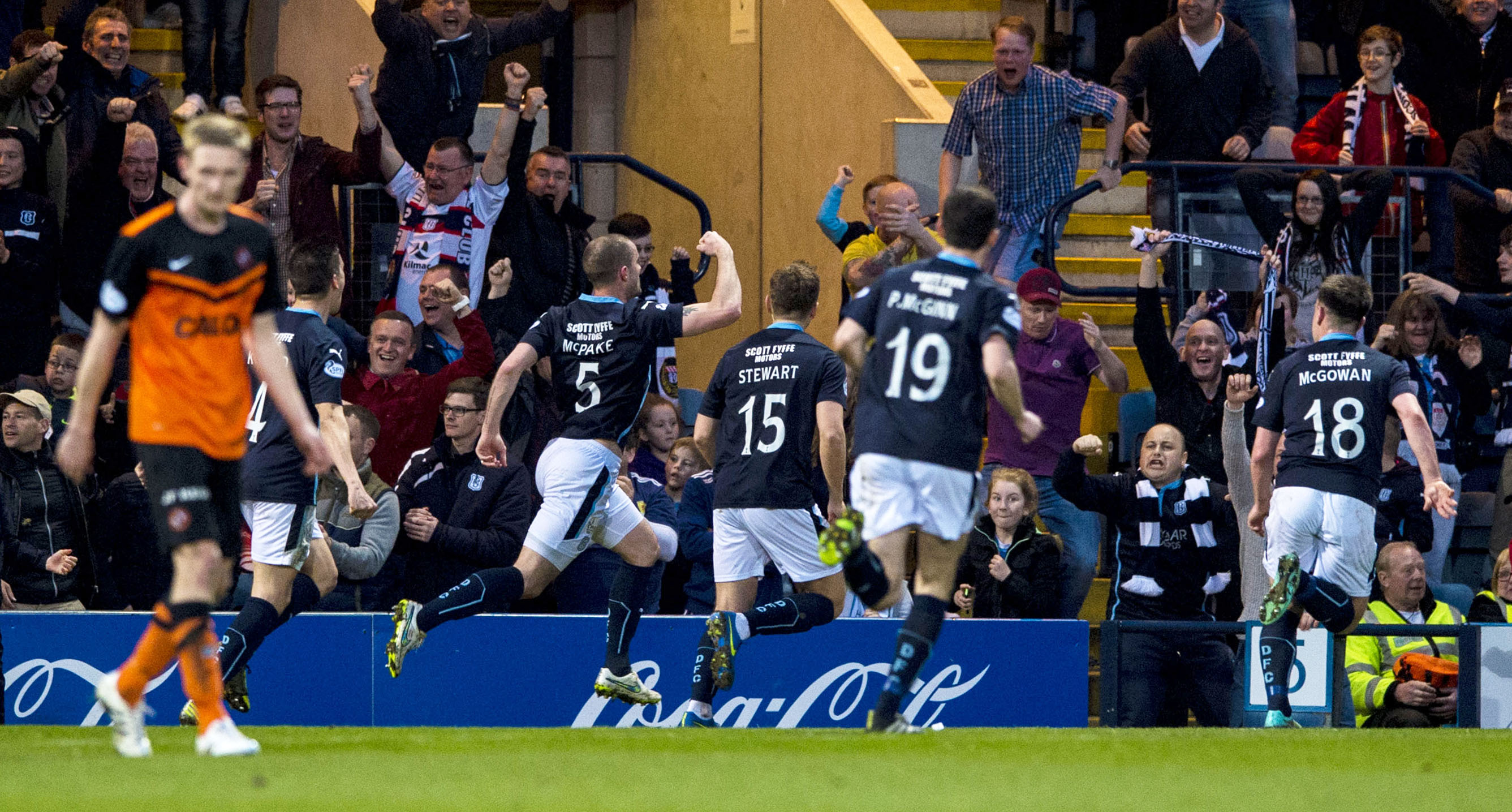 James McPake wheels away in celebration after restoring Dundee's lead in              their 3-1 Premiership derby win over Dundee United in April 2015.