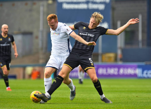 Dundee's Danny Johnson in action with Inverness CT's Coll Donaldson.