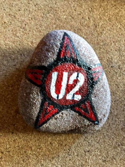 Hopefully this U2 rock was found on a beautiful day.