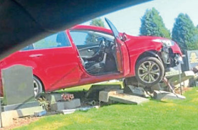 The car at the crash scene.