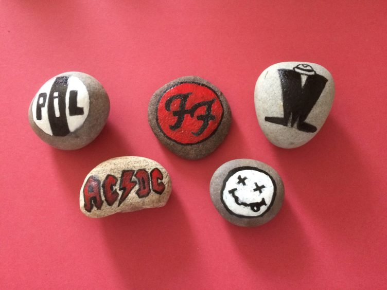 A selection of Karen's designs, including ACDC and the Foo Fighters.