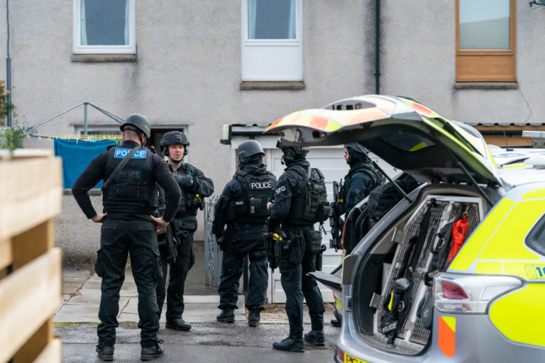 Armed officers at the scene.