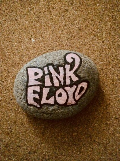I wonder if this Pink Floyd rock was left on a wall somewhere?